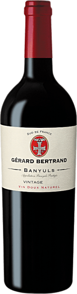 """The Banyuls Vin Doux Naturel by Gérard Bertrand shimmers in the glass in a ruby red with violet reflections. It unfolds its delicious bouquet with the aromas of sweet ripe cherries, blackberries and black currants. These fruity notes are rounded off by a hint of spicy caramel. This red wine is full and balanced with the nuances of blackcurrants and blackberries with a pronounced woody note. Hints of cherry jam lead into the long fruity finale, which convinces with fine spices and chocolaty accents. Vinification for the Gérard Bertrand Banyuls This French dessert wine is vinified from Grenache Noir (80%) and Grenache Gris (20%). The overripe grapes are selectively hand-picked, completely destemmed and lightly squeezed before starting the traditional fermentation process. Before the end of the alcoholic fermentation, this is stopped by the addition of high-percentage alcohol to the mash. This process is called """"mutage sur grains"""". By this step, this wine preserves its high residual sweetness and reaches its high alcohol content. The extended maceration time of 3 weeks supports the optimal extraction of fruit flavors and tannins. Part of this red wine is now being matured in oak barrels and the rest in stainless steel tanks to give the Gérard Bertrand Banyuls its interplay of roasted aromas and fresh fruit. Food recommendation for the Gérard Bertrand Banyuls Enjoy this red dessert wine with desserts with berries, mousse au chocolat or savory cheese. Served at a young age and chilled, this wine is also suitable as an aperitif and with air-dried ham and fine goose liver pate."""