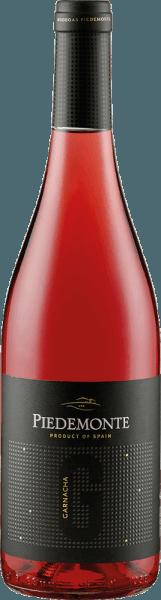 Der Rosado von Piedemonte präsentiert sich im Glas in einer intensiven und brillianten Erdbeerfarbe, welche von veilchenartigen Tönen durchzogen wird. Das Boquet dieses Roséweines ist intensiv mit den Aromen von roten Beeren, insbesondere Erdbeeren und Himbeeren und erinnert an rote Grütze. Dieser spanische Wein aus dem Navarra ist am Gaumen vielschichtig mit einer animierenden Säure und wird vo fruchtigen Aromen in den leicht sauren Abgang begleitet. Vinifikation für den Rosado von Piedemonte Dieser Rosado besteht zu 100% aus der Rebsorte Garnacha. Nach dem Prozess des Abbeerens, der den Most von den Traubenresten abtrennt, beginnt die Entschleimung und die Gärung bei einer kontrollierten Temperatur zwischen 15 und 18 ° Celsius. Nach der alkoholischen Gärung wird das Stabilisierungsverfahren des Weines eingeleitet, gefolgt von seiner Flaschenabfüllung. Speiseempfehlung für den Rosado von Piedemonte Genießen Sie diesen trockenen Roséwein zu Vorspeisen, Antipasti und Tapas, Pasta oder zu Geflügel und hellem Fleisch. Auszeichnungen für den Rosado von Piedemonte Guia Penin: 85 Punkte (Jahrgang 2013) Guia Penin: 87 Punkte (Jahrgang 2012) Guia Penin: 86 Punkte (Jahrgang 2010)