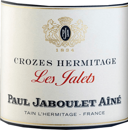 At the sight of the Crozes Hermitage Les Jalets Rouge by Domaine Paul Jaboulet Aîné, a beautiful, shiny ruby red colour with violet highlights appears. The aromatic bouquet reminds of red, sour forest berries with a final spicy note. The palate with the full attack is well balanced and smooth, with depth, beautiful fullness and fine liquorice notes in the finish, a wonderful pleasure to juicy grilled entrecote with green pepper, lamb stew with braised shallots or smoked shallots in a dough coat.