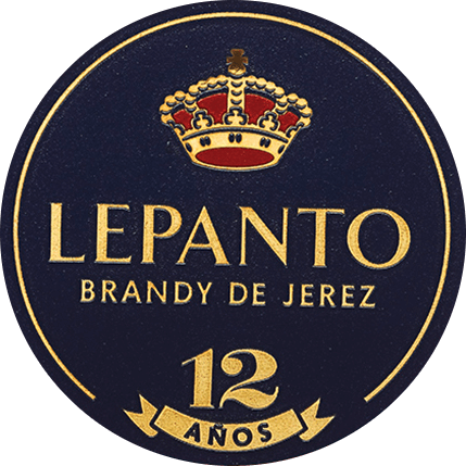 The Lepanto Solera Gran Reserva from Gonzalez Byass from the Spanish wine-growing region DO Jerez is exclusively distilled from the grape variety Palomino Fino. This brandy shines in the glass in a luminous topaz with orange-golden shades. The nose reveals an elegant bouquet with fine notes of raisins, nuts, almonds, vanilla and caramel. Its dry, mature and complex taste reflects the warm spicy aromas of the bouquet and is crowned by a long and velvety finish. Vinification of Byass Solera Gran Serva Lepanto For this brandy only selected, best Palomino Fino grapes are used and pressed in the wine cellar of Bodega Los Arcos. The fine must is quickly fermented and then burnt twice in copper boilers. The copper kettles are two original Alambics Charentais with a volume of 25hl. Only the fine brandy with 65 to 72 percent by volume is used for this brandy and placed in the Solera and Criadera system for a total of 12 years. These are 600 litres of American oak barrels, which are also used for sherry production. For 9 years this brandy matures in former Tío Pepe barrels - the remaining 3 years in Matusalem Cream Sherry barrels. Serving recommendation for the Lepanto Solera Gran Reserva Enjoy this Brandy de Jerez as a nice conclusion of a cosy meal, or also to spicy blue cheese. But also pure (also on ice) this brandy is a pleasure.